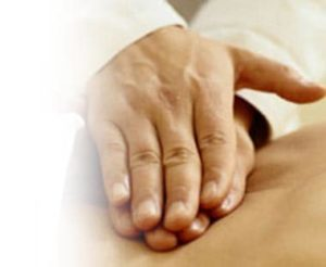 Perth Chiro's hands doing complete care chiropractic techniques